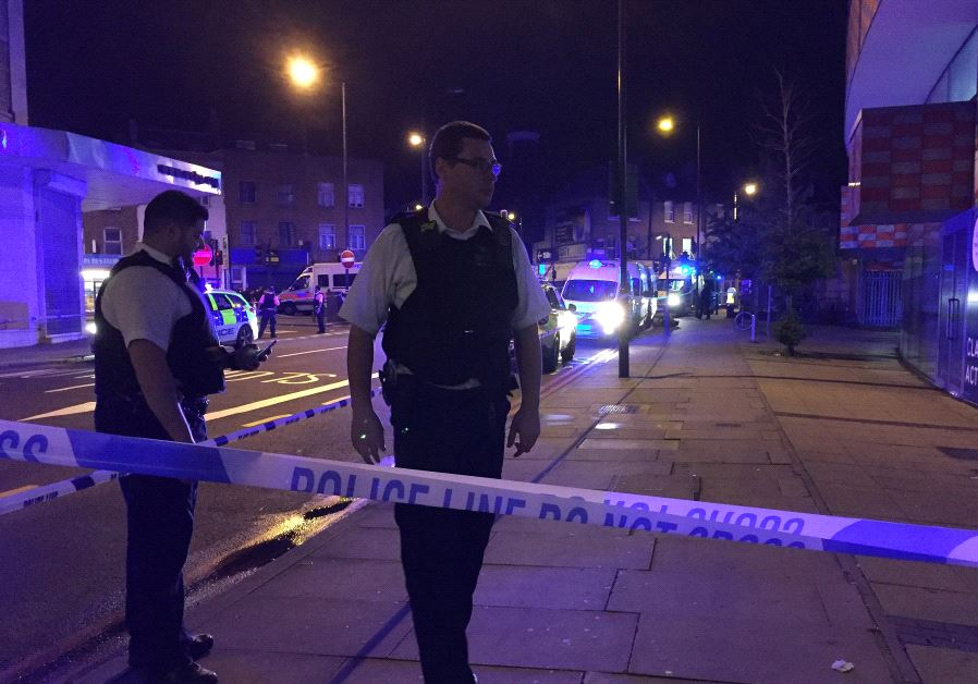 Police are seen near Finsbury Park as British police say there are casualties after reports of vehic