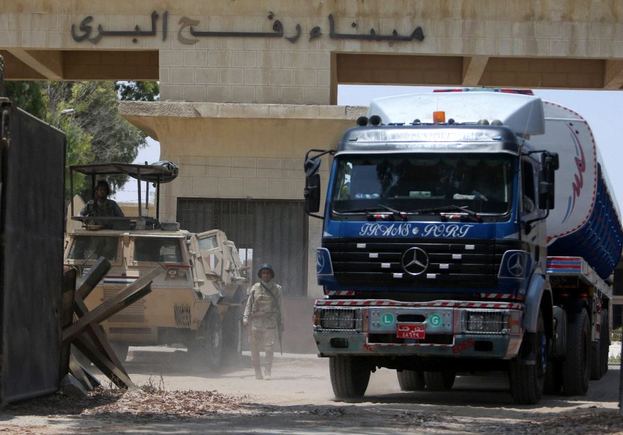 Egyptian soldiers stand guard at the border as fuel tankers enter Gaza through the Rafah border.