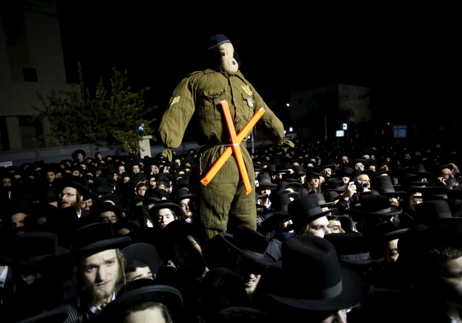 Ultra-Orthodox Jews attend a protest in December 22, 2015.