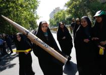 An Iranian girl holds a model of a missile during a rally marking al-Quds (Jerusalem) Day in Tehran.