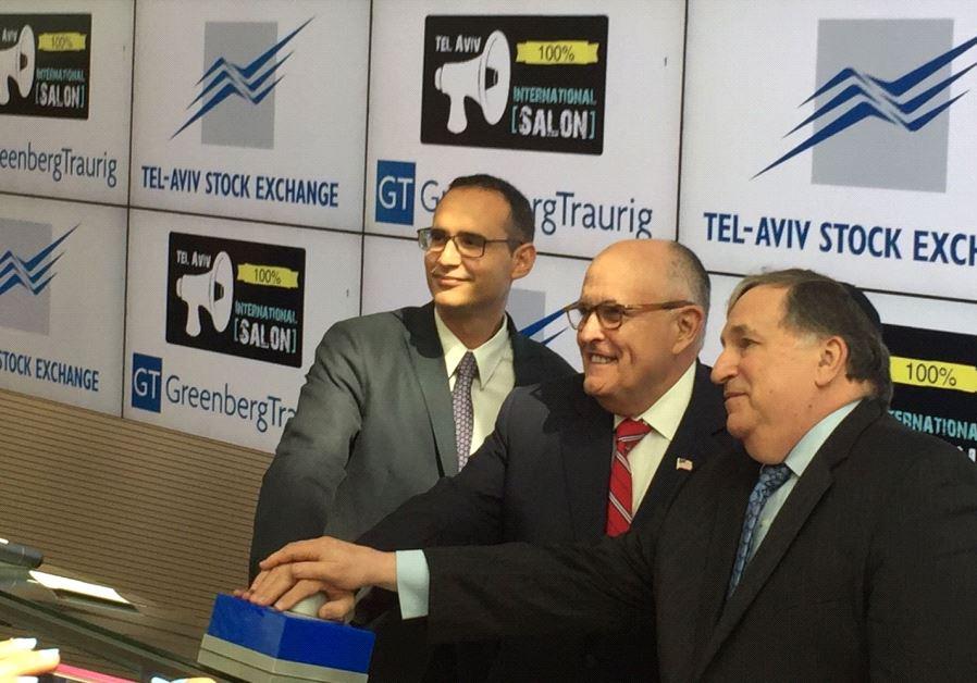 Rudy Giuliani (center) rings the opening bell at the Tel Aviv Stock Exchange, June 28 2017.