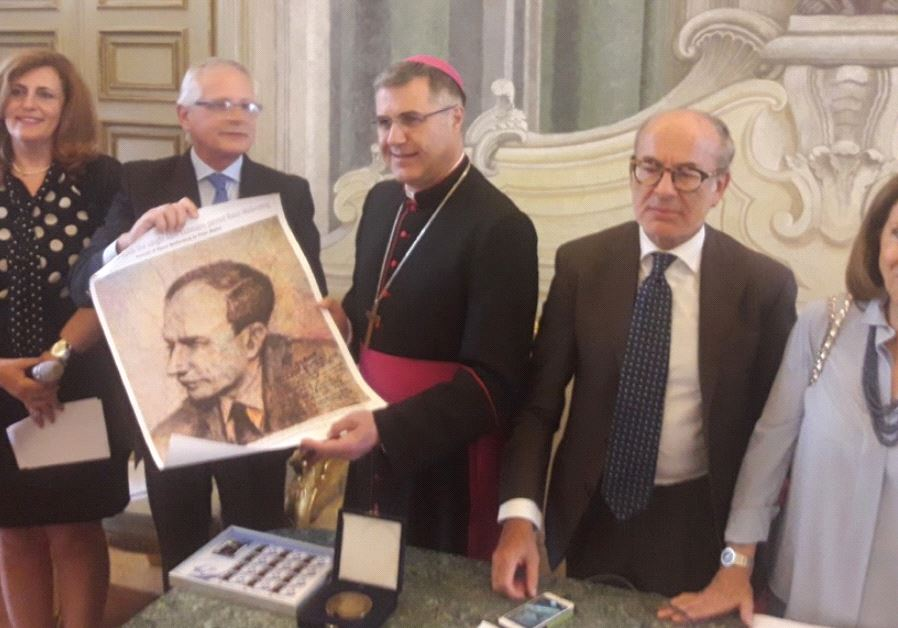 PALERMO ARCHBISHOP Corrado Lorefice holds a portrait of Raoul Wallenberg yesterday, together with (f