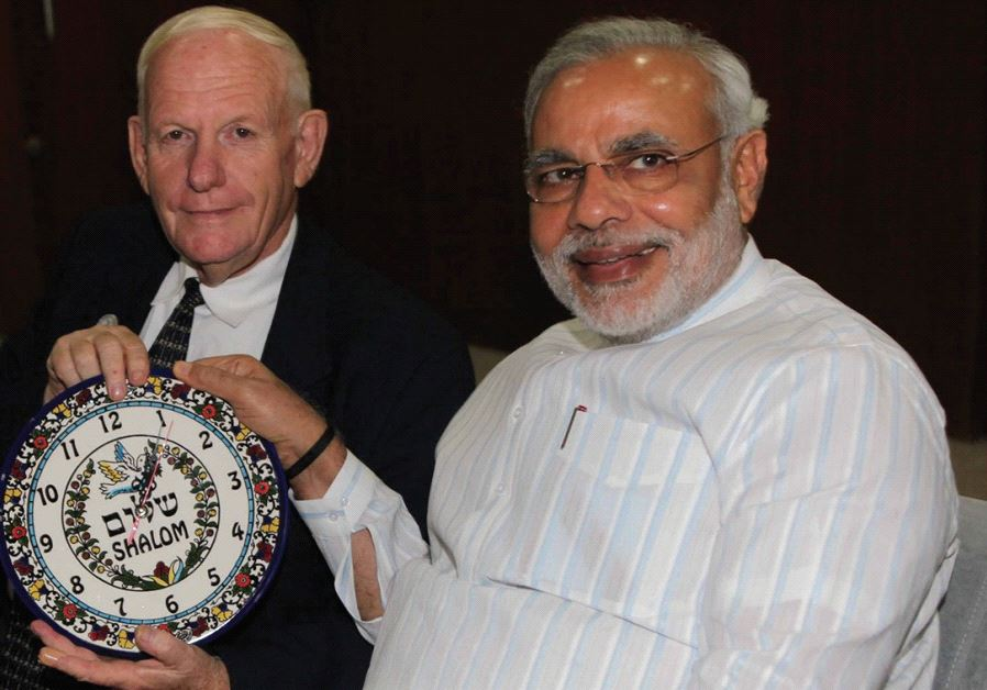 AMNON OFEN, director of NaanDanJain Irrigation, presents a clock to Narendra Modi in 2013.