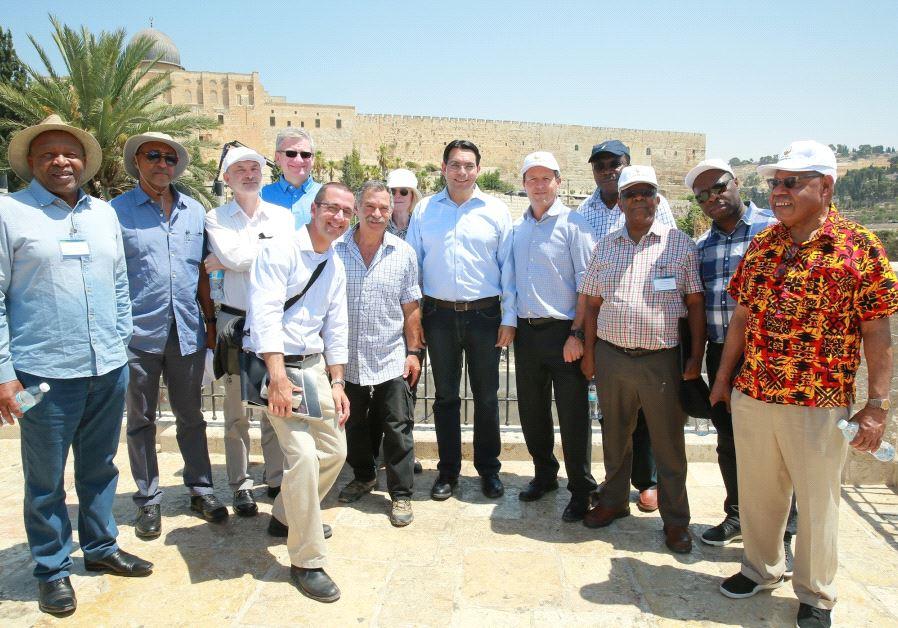 Israel's Ambassador to the UN Danny Danon guides counterparts through a tour of Jerusalem