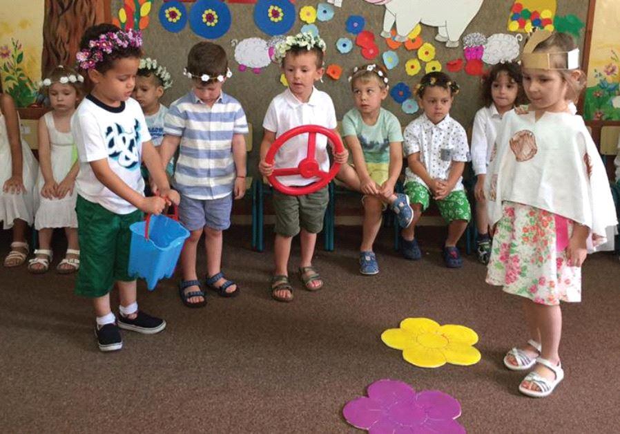 CHILDREN IN PRESCHOOL. Committee chairman Eli Alalouf says early identification of developmental pro