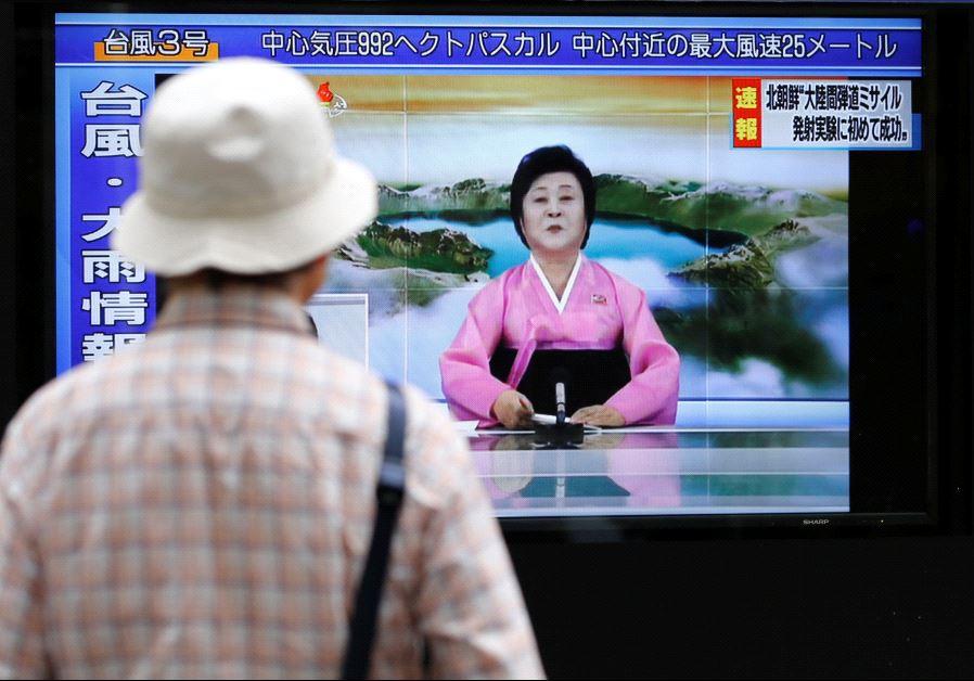 A man looks at a TV showing news of North Korea firing a ballistic missile in Tokyo, July 4 2017.(REUTERS/TORU HANAI)