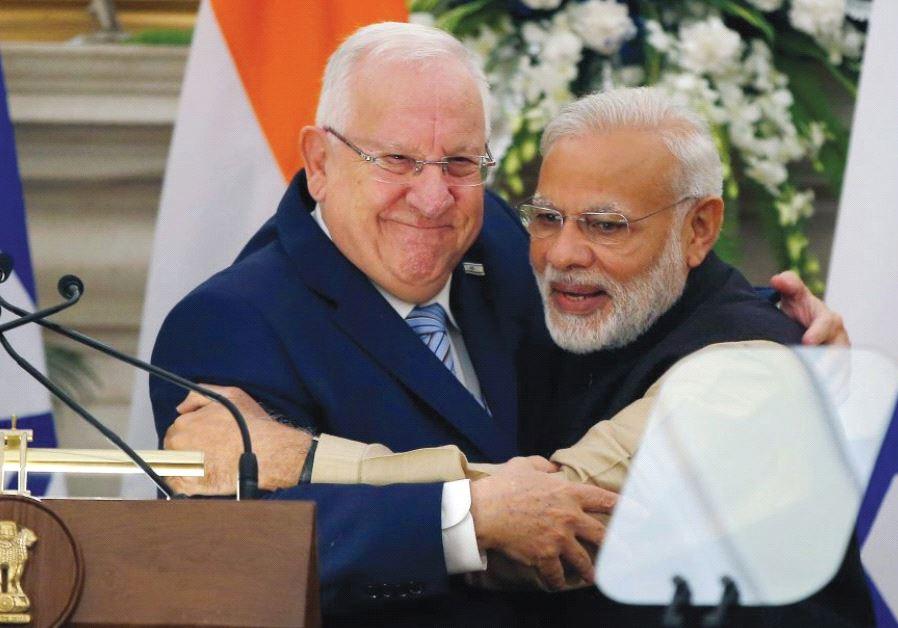 PRESIDENT REUVEN RIVLIN receives a bear hug from Indian Prime Minister Narendra Modi during Rivlin's