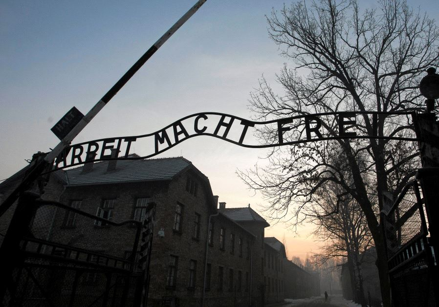 "The Nazi slogan ""Arbeit macht frei"" (Work sets you free) is pictured at the gates of the former Nazi German concentration and extermination camp Auschwitz-Birkenau in Oswiecim, Poland January 27, 2017 (photo credit: AGENCY GAZETA/KUBA OCIEPA/VIA REUTERS)"
