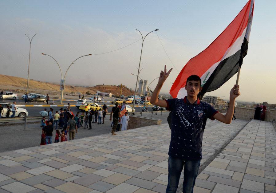 Man waving Iraqi flag in Mosul, July 9