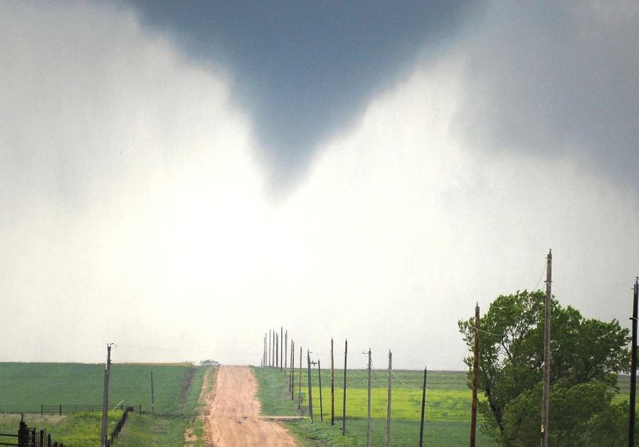 A TORNADO forms over the fields of Kansas.