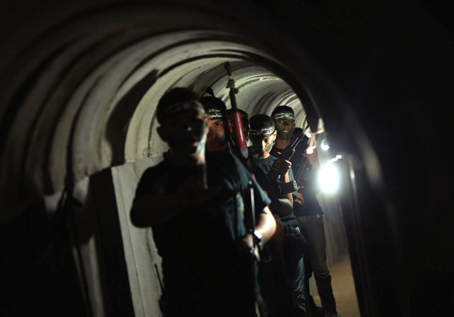 Young Palestinians advance through a tunnel during a military exercise organized by Hamas, east of Gaza City (Reuters)