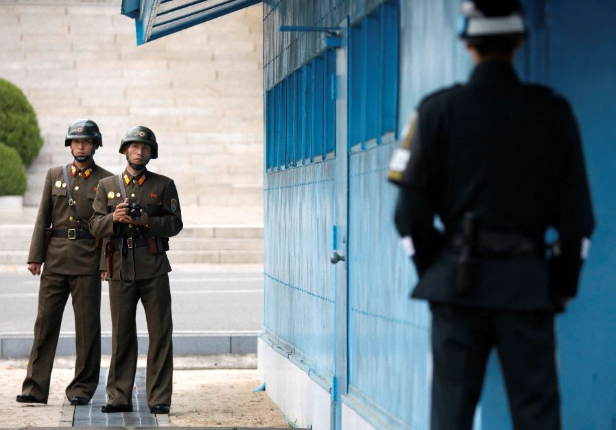 North Korean soldiers keep watch toward the south, April 17, 2017.
