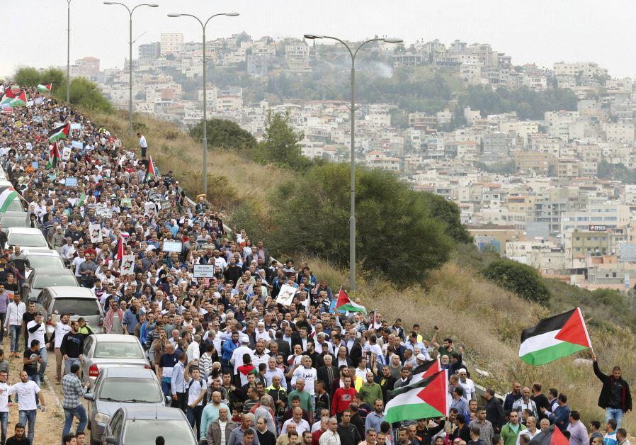 Israeli Arab protesters shout slogans during a demonstration in Umm el-Fahm.