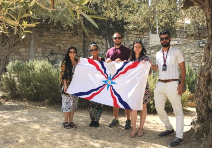PARTICIPANTS in the Assyrian youth trip to Israel organized by the Philos Leadership Institute hold