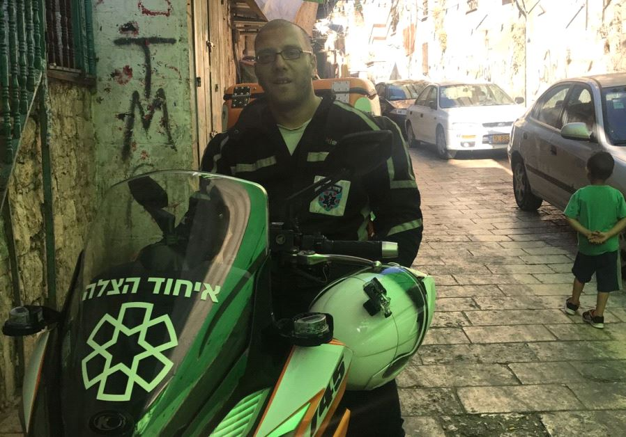 Nedal Sader with his ambucycle in Jerusalem's Old City (credit: Courtesy -  United Hatzalah)