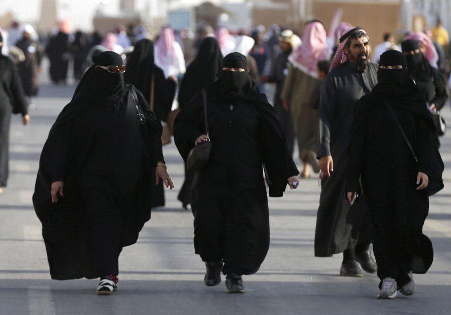 Women in typical Saudi dress (photo credit: REUTERS/FAISAL AL NASSER)