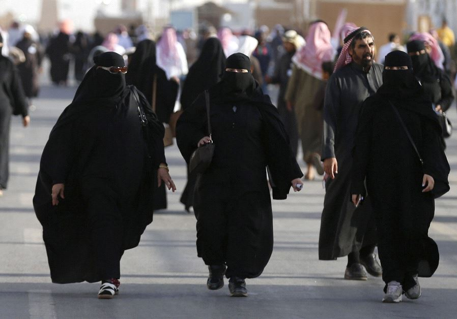 Women wearing traditional Saudi clothing, or an abaya