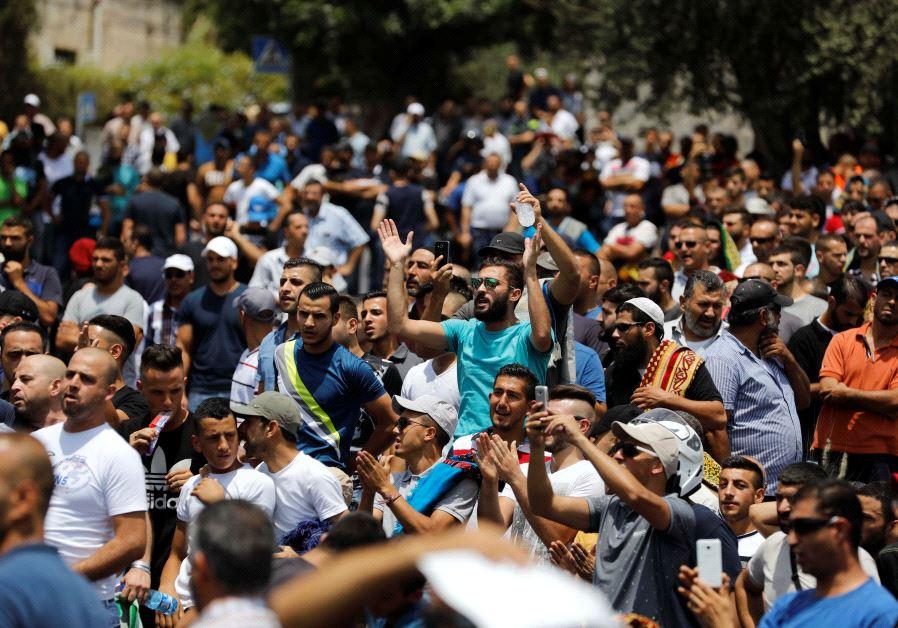 Palestinians shout slogans as they protest outside Jerusalem's Old city July 21, 2017.