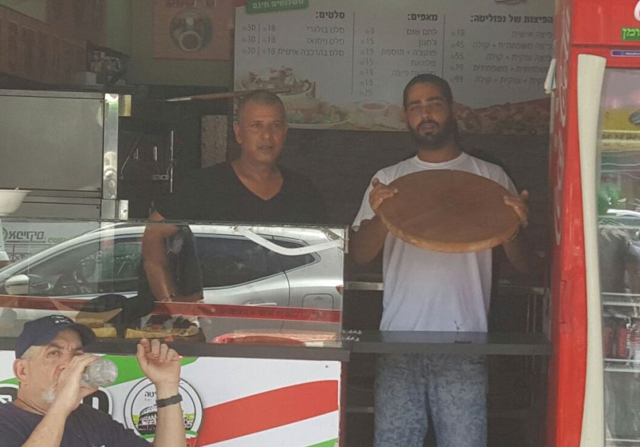 Shlomi Madar, the owner of a pizza restaurant who subdued the terrorist in Petah Tikva. (Alon Hachmon)