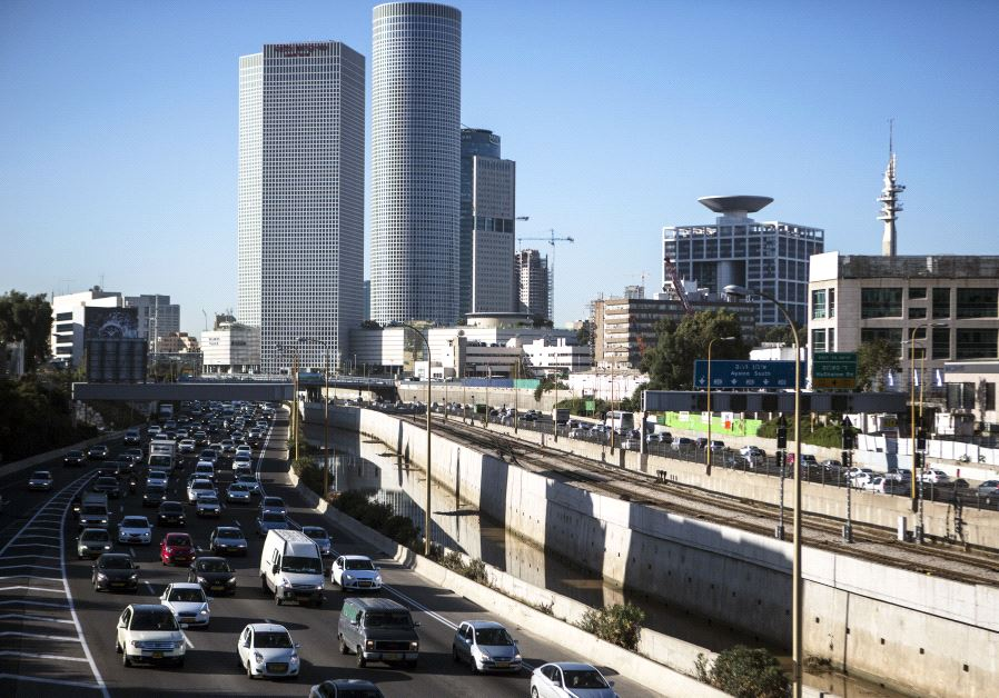 Vehicles drive on a highway in the central Israeli city of Tel Aviv December 17, 2013.