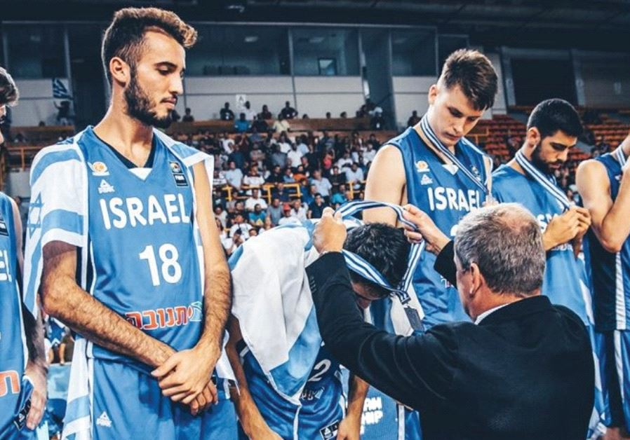 Israel's players couldn't hide their disappointment when receiving their silver medals.