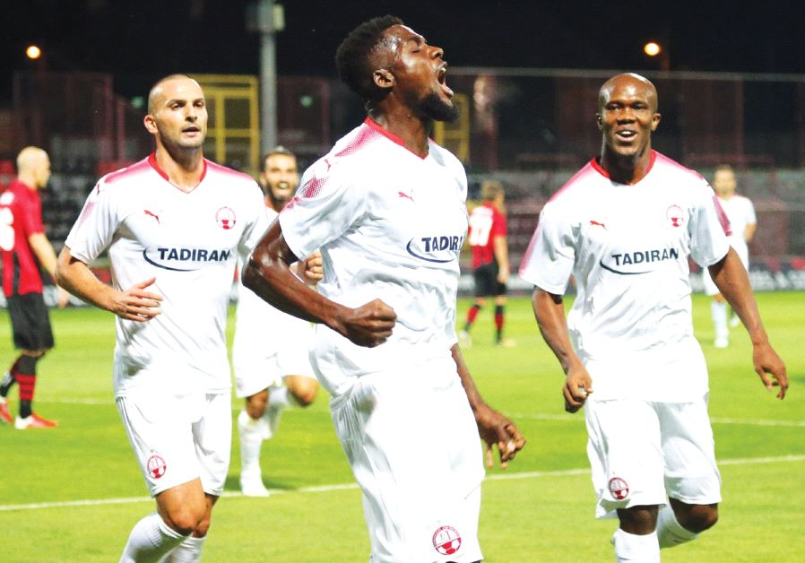 Hapoel Beersheba could use another scoring contribution from midfielder John Ogu (center) tonight, w