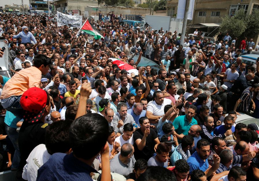 People attend the funeral of Mohammad Jawawdah in Amman, Jordan July 25, 2017.