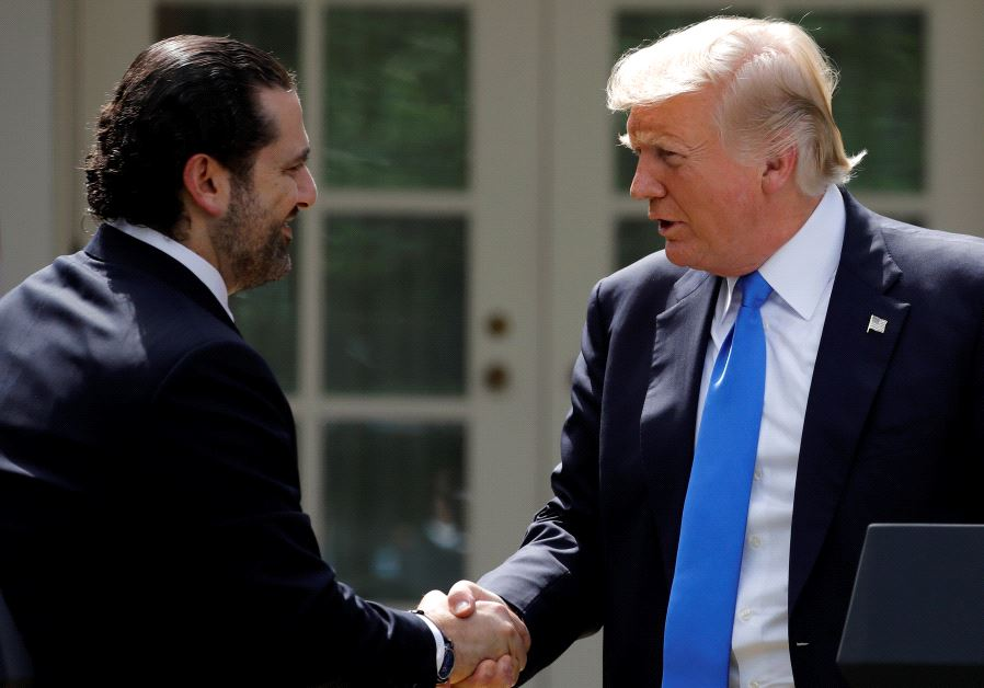 US President Donald Trump shakes hands with Lebanese Prime Minister Saad al-Hariri during a press co