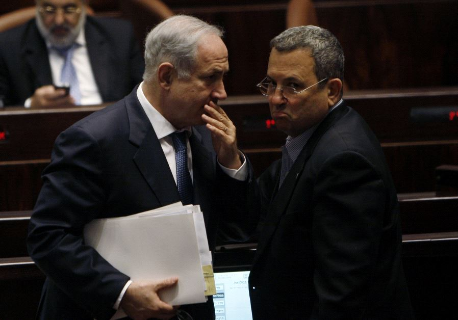 Israel's Prime Minister Benjamin Netanyahu (L) speaks with Ehud Barak at the Knesset, the Israeli pa