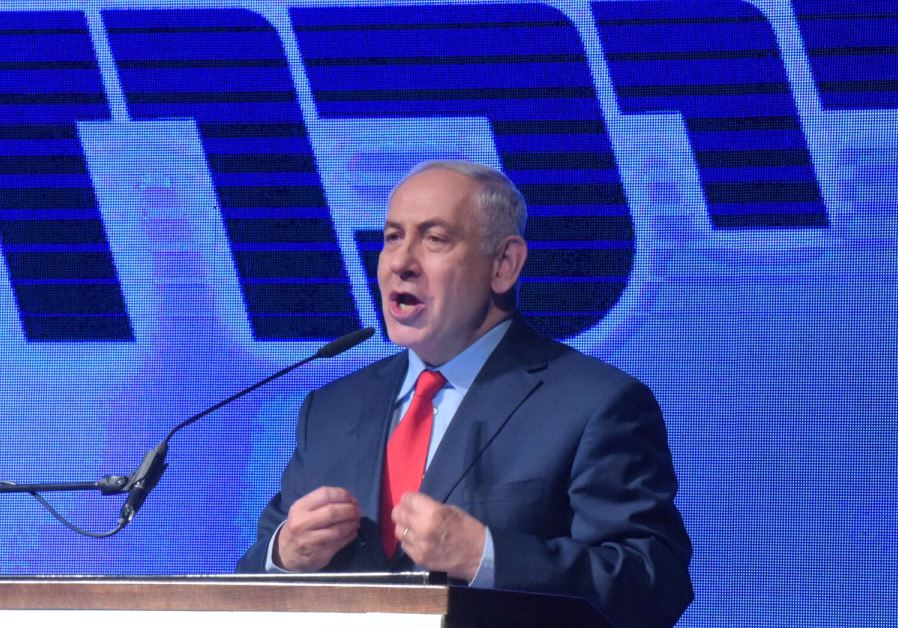 Prime Minister Benjamin Netanyahu speaks at a rally.