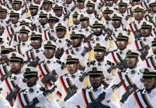 Members of the Iranian Revolutionary Guard Navy march during a parade to commemorate the anniversary