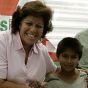 Presidential candiate Lourdes Flores greets street