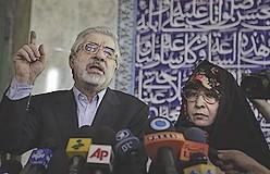 Mousavi speaks to the media with his wife Zahra Ra