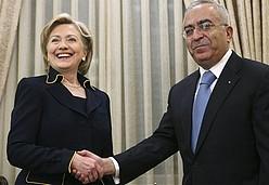 US Secretary of State Hillary Rodham Clinton shake