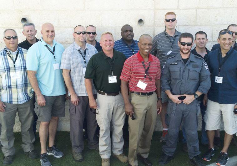 The ADL delegation of senior US law-enforcement officials poses with Israeli National Police officers in Jerusalem (photo credit: ISRAEL POLICE)