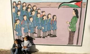 Palestinian kids sit at UNRWA school
