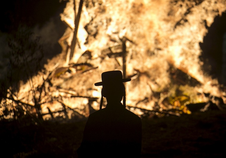 Orthodox man stands in front of a bonfire in Bnei Brak (Photo by: Reuters)
