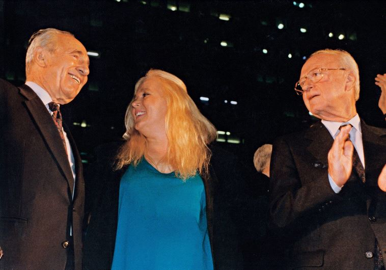 Shimon Peres sings alongside Miri Aloni and Yitzhak Rabin at a peace rally in Tel Aviv on November 4, 1995. Rabin was assassinated shortly afterward (photo credit: NOAM WIND)