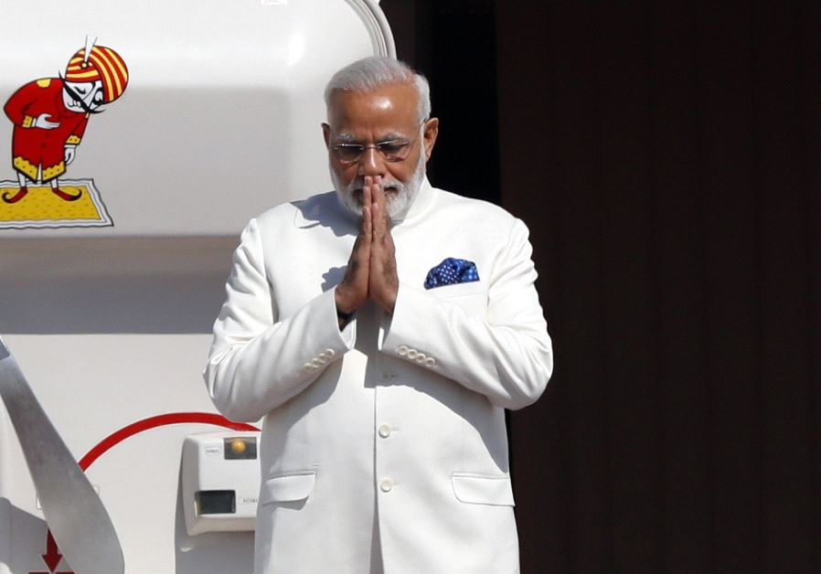 Indian Prime Minister Narendra Modi gestures as he disembarks from his plane upon his arrival at Ben-Gurion International airport near Tel Aviv on July 4, 2017 (JACK GUEZ / AFP)