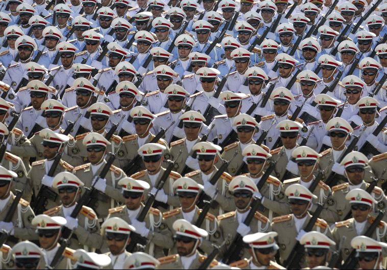 Iranian soldiers march during the annual military parade marking the anniversary of the start of Iran's 1980-1988 war with Iraq, on September 21, 2016, in Tehran (CHAVOSH HOMAVANDI/AFP)